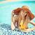 mujer · hermosa · traje · de · baño · pie · playa · puesta · de · sol · mujer - foto stock © dashapetrenko