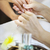 woman in nail salon receiving manicure by beautician stock photo © dashapetrenko