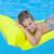 little girl swimming on inflatable beach mattress stock photo © dashapetrenko