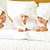 happy mother and girls in bathrobes in bedroom family care and stock photo © dashapetrenko