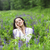 happy pretty brunette woman in flower field stock photo © dashapetrenko