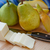 cut pear with whole pears and sliced cheese stock photo © dbvirago