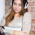 cute woman listening music in headphones stock photo © deandrobot