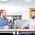 twee · zakenlieden · glimlachend · vergadering · tabel · samen - stockfoto © deandrobot