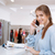 happy young woman talking on cell phone in clothing store stock photo © deandrobot