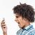 afro amerian man screaming on smartphone stock photo © deandrobot