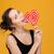 lovely playful woman licking sweet heart shaped lollipop stock photo © deandrobot