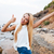 happy woman standing and showing thumbs up on the beach stock photo © deandrobot