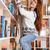 молодые · улыбающаяся · женщина · книга · библиотека · шельфа - Сток-фото © deandrobot