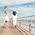 back view of two pretty young women walking on pier stock photo © deandrobot