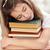 schoolgirl dreaming on books sitting at the table stock photo © deandrobot