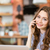 beautiful positive young woman talking on cellphone stock photo © deandrobot
