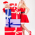 attractive women in santa claus dresses posing with colorful gifts stock photo © deandrobot