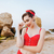 young beautiful pin up girl in red swimsuit posing stock photo © deandrobot