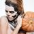 portrait of girl with fearful halloween makeup holding pumpkin stock photo © deandrobot