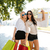 two woman walking on the street carrying shopping bags stock photo © deandrobot