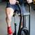 függőleges · kép · izmos · férfi · bicikli · tornaterem - stock fotó © deandrobot