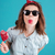 portrait of a funny stylish girl in sunglasses showing tongue stock photo © deandrobot