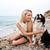 joli · jeune · femme · séance · plage · roches · soleil - photo stock © deandrobot