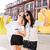 two elegant happy women walking in the city street stock photo © deandrobot