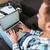 剛毛 · 男 · 座って · ソファ · ラップトップを使用して - ストックフォト © deandrobot