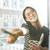 молодые · улыбаясь · азиатских · женщину · подоконник · очки - Сток-фото © deandrobot