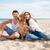 genç · gülen · çift · sevmek · oturma · plaj - stok fotoğraf © deandrobot