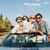 cheerful young friends driving car in summer stock photo © deandrobot