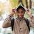 africaine · homme · posant · à · l'extérieur · visage · fond - photo stock © deandrobot
