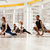 multiethnic group of young people practicing yoga together stock photo © deandrobot