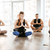 group of people sitting and meditating at yoga studio stock photo © deandrobot