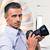 handsome photographer holding camera stock photo © deandrobot