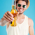 man in hat and sunglasses giving you bottle of beer stock photo © deandrobot