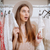 surprised curious woman standing in clothing store and looking away stock photo © deandrobot