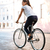 young brunette woman riding on bicycle in street stock photo © deandrobot