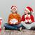 kettő · boldog · gyerekek · mikulás · sapkák · tart - stock fotó © deandrobot