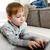 utilisant · un · ordinateur · portable · maison · enfants · heureux · enfant - photo stock © deandrobot