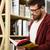 élégant · garçon · barbe · verres · lecture · livre - photo stock © deandrobot