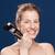 smiling woman holding makeup brushes stock photo © deandrobot
