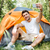 mosolyog · férfi · turista · elvesz · okostelefon · turisztikai - stock fotó © deandrobot