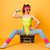 happy fitness woman sitting on retro boombox and showing biceps stock photo © deandrobot