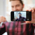 bearded young man make a selfie by mobile phone stock photo © deandrobot