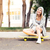 girl resting with skateboard outdoors stock photo © deandrobot