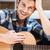 człowiek · muzyki · domu · kanapie · młody · człowiek - zdjęcia stock © deandrobot