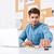 empresário · trabalhando · laptop · escritório · caneta - foto stock © deandrobot