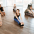 multiethnic group of people stretching at yoga studio stock photo © deandrobot