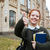 smiling pleased female student holding books and showing thumbs up stock photo © deandrobot
