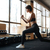fitness woman working out and doing squats in gym stock photo © deandrobot