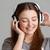derűs · fiatal · nő · zenét · hallgat · fejhallgató · szürke · nő - stock fotó © deandrobot