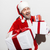 happy man santa claus holding present boxes and laughing stock photo © deandrobot